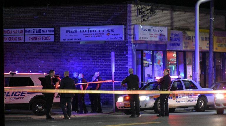 Nassau County police investigate the scene where a