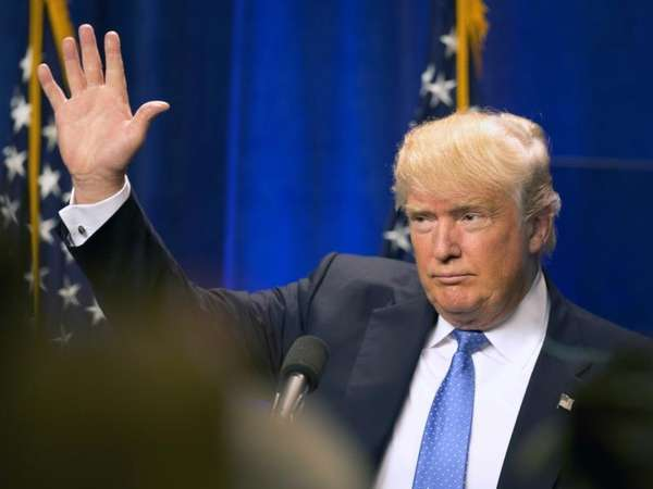 Republican presidential candidate Donald Trump waves to supporters