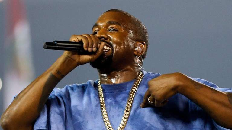 Kanye West performs during the closing ceremony of