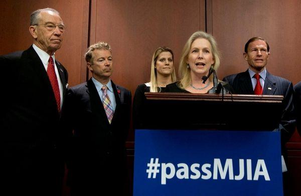 Sen. Kirsten Gillibrand, front, with, from left, Sen.