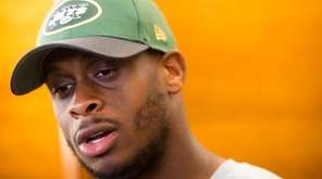 New York Jets quarterback Geno Smith talks to