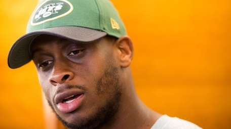 New York Jets quarterback Geno Smith talks to