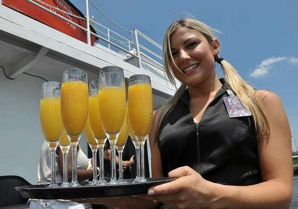 Server Joanna Duda of East Islip offers mimosas