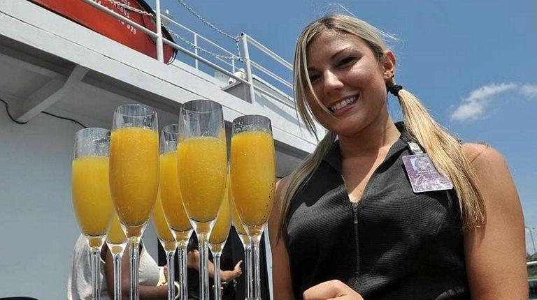 Server Joanna Duda of East Islip offers mimosas
