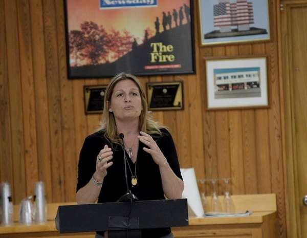 Local musician Nancy Atlas addresses the East Hampton