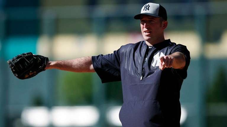 New York Yankees first baseman Ike Davis gestures