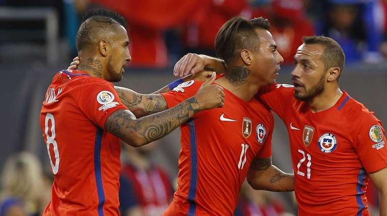 Eduardo Vargas #11 of Chile is congratulated by