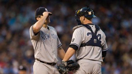 Brian McCann visits Yankees starter Nathan Eovaldi during