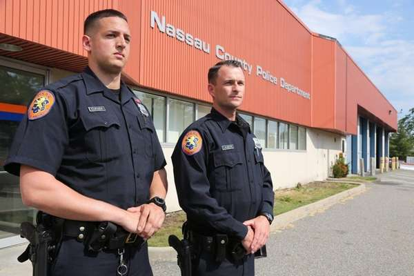Nassau County Police Officers Ronald Curaba, left, and