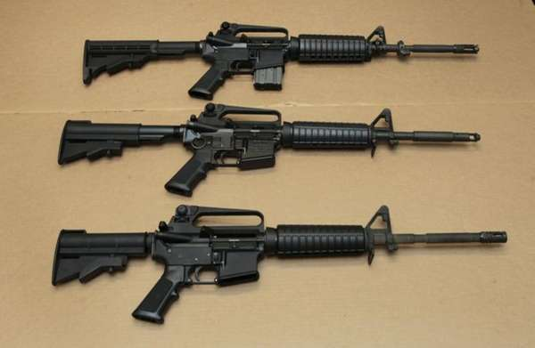 Three variations of the AR-15 assault rifle are