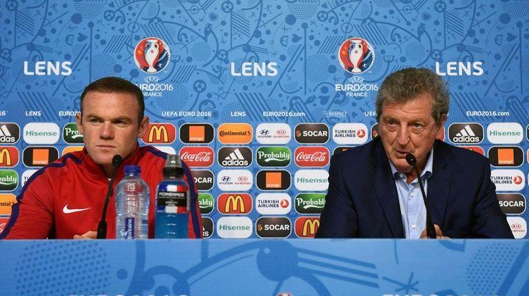 England manager Roy Hodgson (R) and captain Wayne