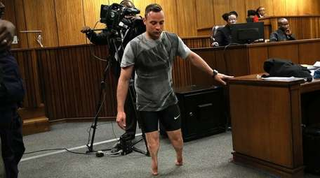 South African Olympian Oscar Pistorius walks without his