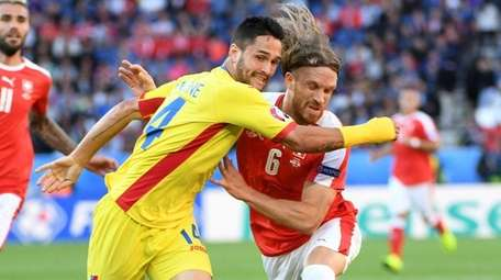 Florin Andone of Romania tries to get past