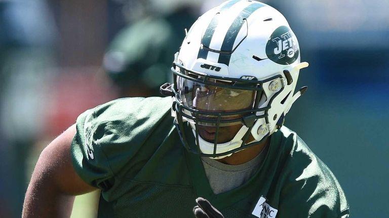 New York Jets linebacker Jordan Jenkins runs a