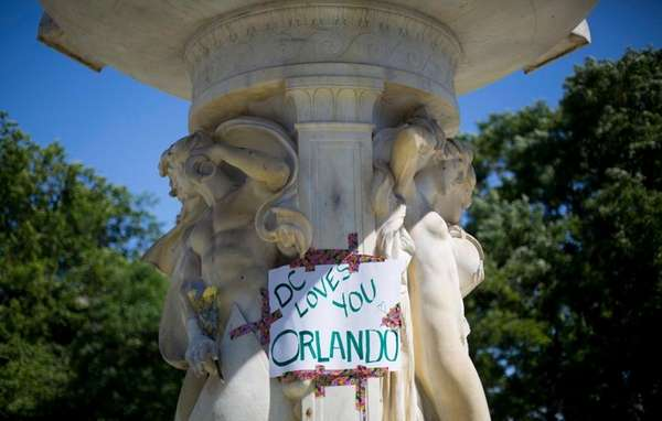 A sign is posted on the fountain at