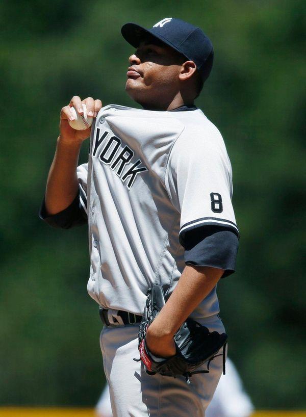 New York Yankees starting pitcher Ivan Nova tries