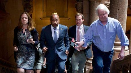 Assembly Speaker Carl Heastie, D-Bronx, is followed by