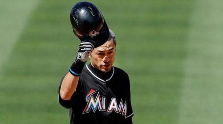 Miami Marlins batter Ichiro Suzuki of Japan tips