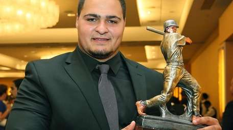 Carey's Anthony Catapano holds his Don Lang Diamond