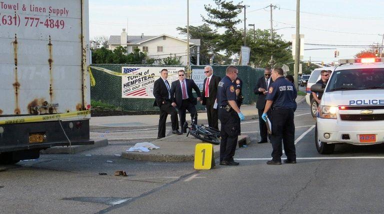 Police respond to the scene where a bicyclist