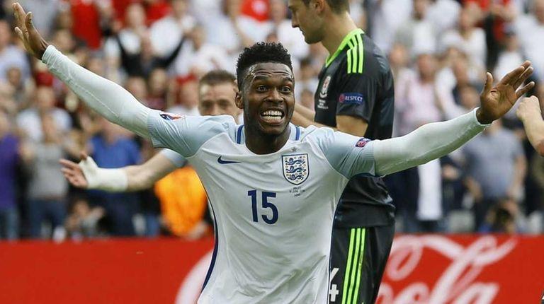 England's Daniel Sturridge celebrates after scoring his side's