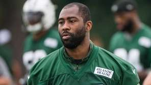New York Jets cornerback Darrelle Revis looks on
