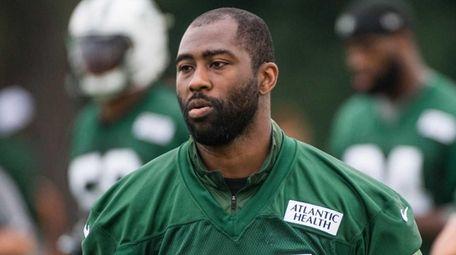 New York Jets cornerback Darrelle Revis looks on