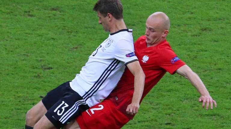 Thomas Mueller (L) of Germany and Michal Pazdan
