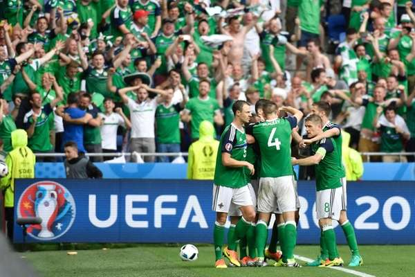 Northern Ireland's midfielder Niall McGinn celebrates scoring a