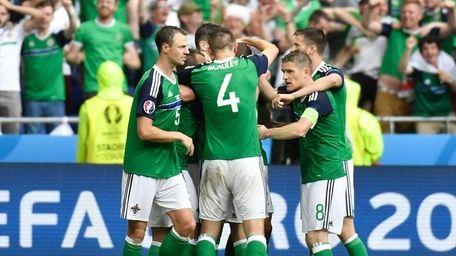 Northern Ireland's midfielder Niall McGinn celebrates scoring a