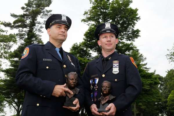 Nassau police Officer Nicholas Brando, left, and Suffolk