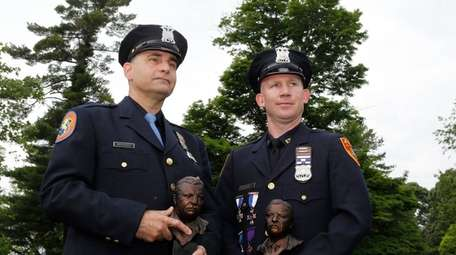 Nassau police Officer Nicholas Brando, left, and Suffolk