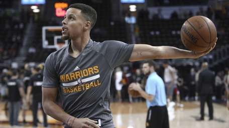 Golden State Warriors' Stephen Curry shoots during warmups