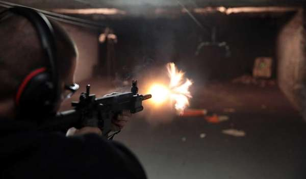 An AR-15 is fired at an indoor range