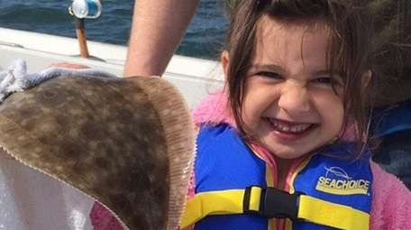 Valentina Balducci,age 5, caught her first fish, Fluke.