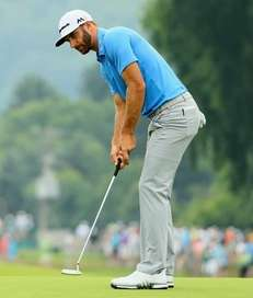 Dustin Johnson of the United States putts on