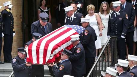 Family members of FDNY Chief Lawrence Stack, including