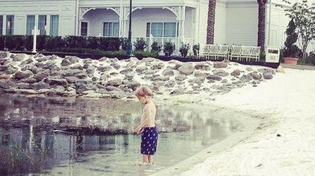 Jennifer Venditti's son wades in Seven Seas Lagoon