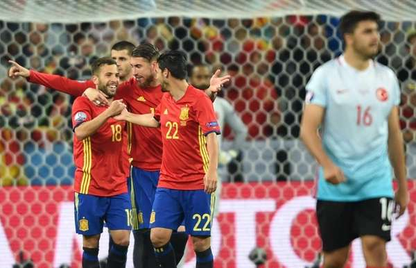 Spain's players celebrate their third goal during the
