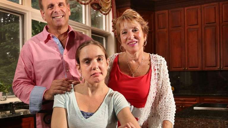 Rachael Eisenson, center, is shown with her parents