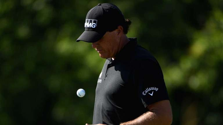 Phil Mickelson of the United States waits on