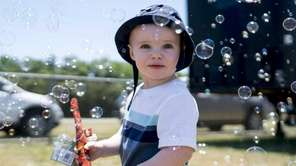 Mason Bilka, 1, of Patchogue frolics in hundreds