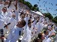 Graduates celebrate during the eightieth commencement exercises of