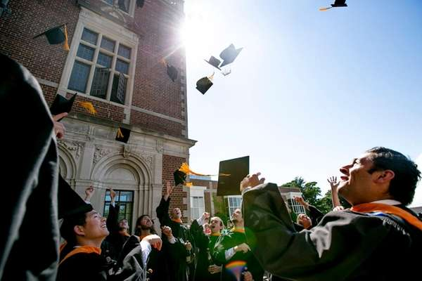 The graduates celebrate after their commencement ceremony at