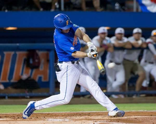 Florida first baseman Peter Alonso connects for a