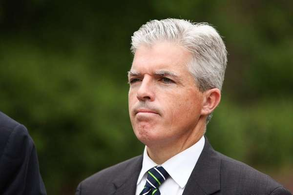 Suffolk County Executive Steve Bellone looks on during