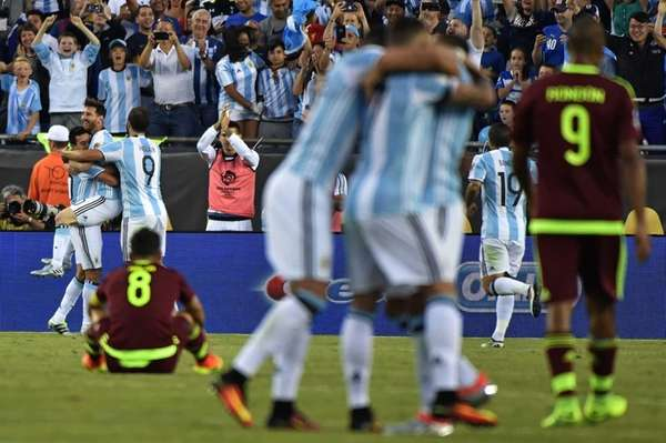 Argentina's Lionel Messi celebrates with teammates his goal
