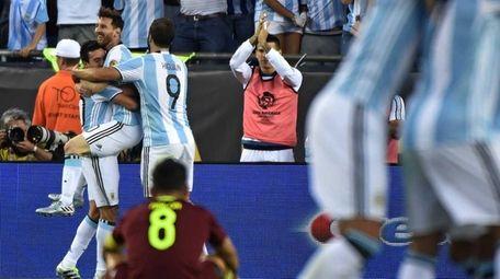 Argentina's Lionel Messi celebrates with teammates his goal