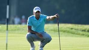 Jason Day of Australia lines up a putt