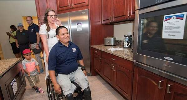 Retired Marine Sgt. Luis Remache and his wife,